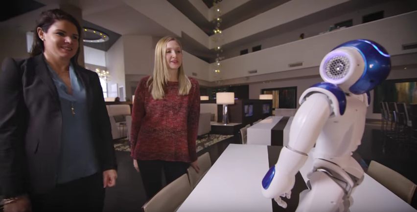 Photo of Nao robot meeting Hilton guests